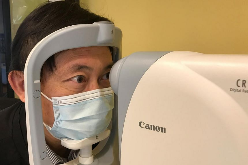 Scientist Benny Zee demonstrates retinal eye scanning technology during an interview in Hong Kong, on Jan 29, 2021.