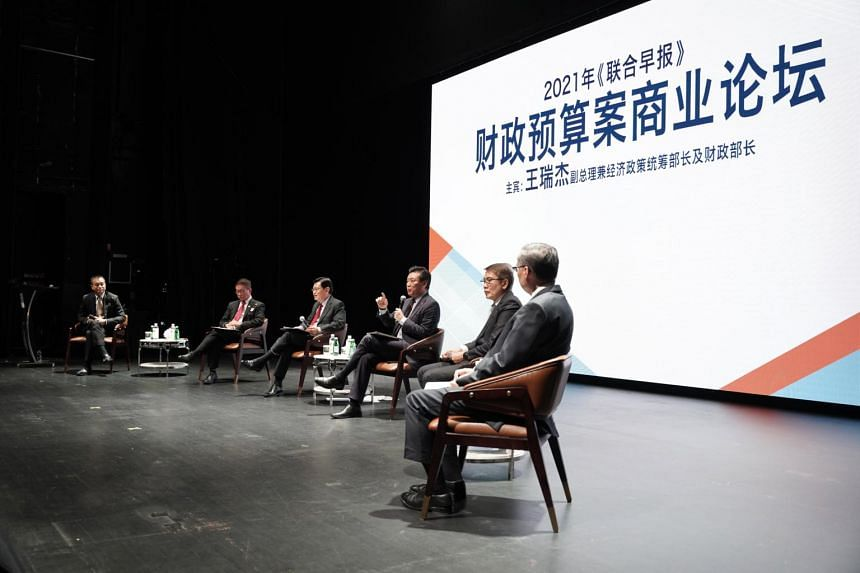Deputy Prime Minister Heng Swee Keat (third from left) with other panellists at the Lianhe Zaobao Singapore Budget 2021 Business Forum.