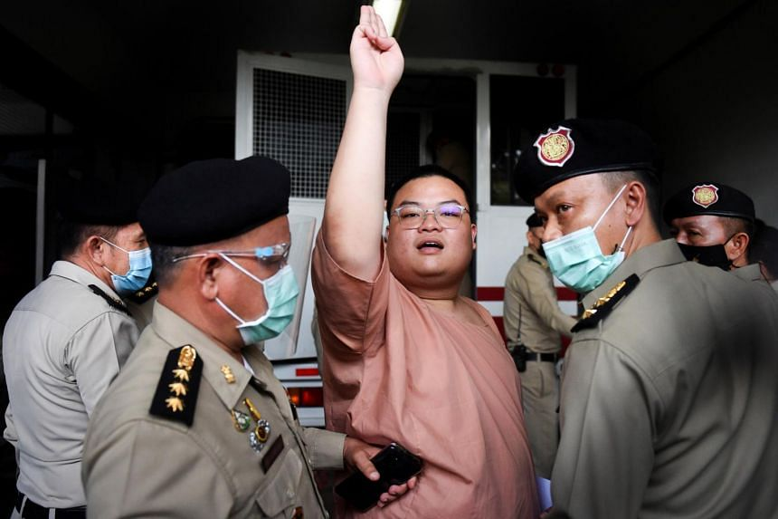 """Arrested anti-government protester Parit """"Penguin"""" Chiwarak at the criminal court in Bangkok, on March 15, 2021."""
