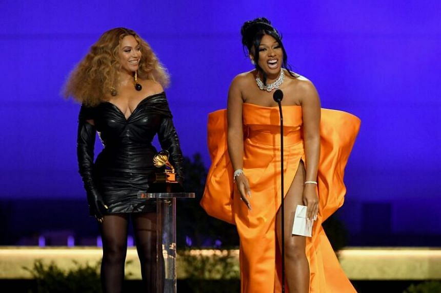 Beyonce (left) and Megan Thee Stallion accept the Best Rap Performance award for Savage onstage on March 14, 2021.