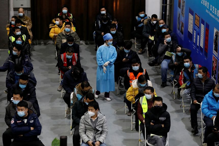 People resting after receiving a dose of Covid-19 vaccine in Beijing on Jan 15, 2021.