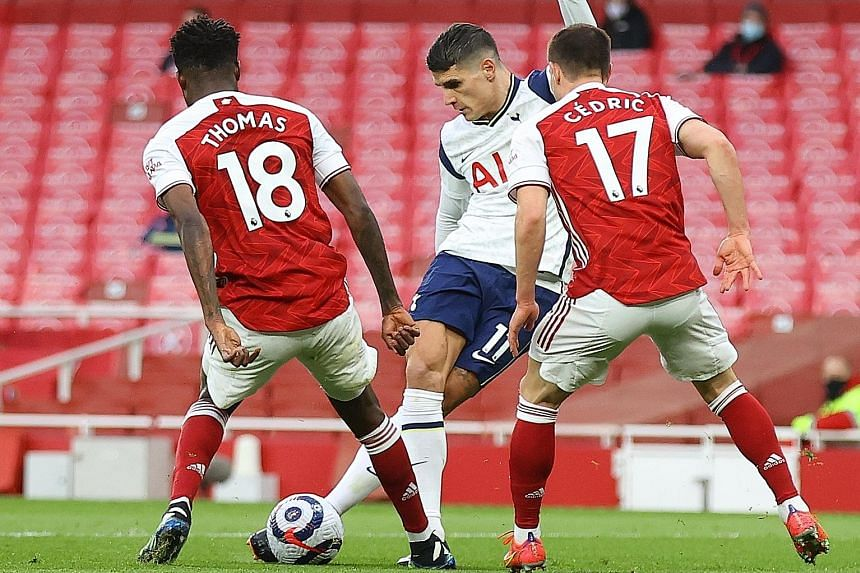 """Left: Spurs' Erik Lamela displaying great skill to score a """"rabona"""" goal past Arsenal's Thomas Partey and Cedric Soares. But Spurs manager Jose Mourinho accused some of his players of """"hiding"""" during the first half, and the Gunners recovered to win 2"""