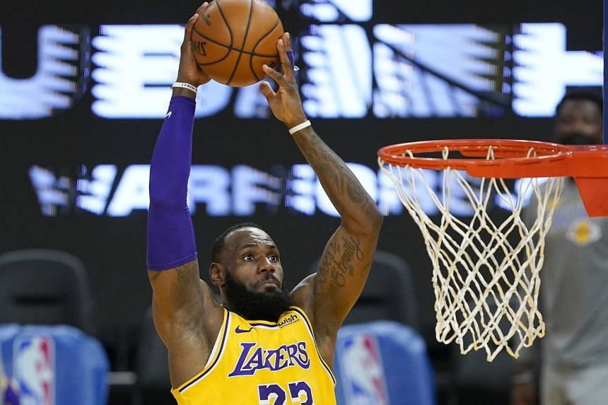 LeBron James goes up for a slam dunk against the Golden State Warriors at the Chase Centre on March 15, 2021.