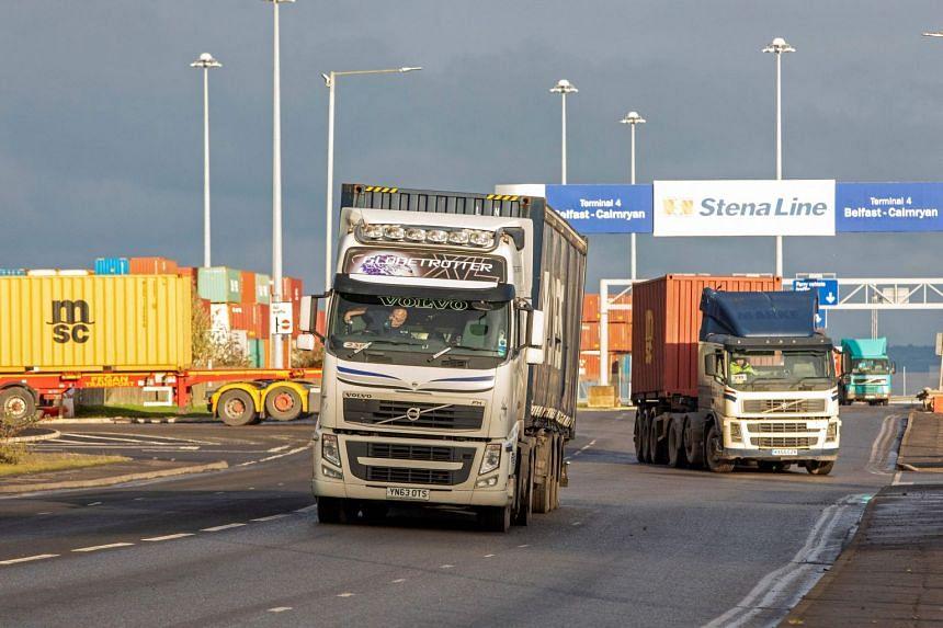 In a file photo taken on Dec 10, 2020, lorries leave the docks area in Belfast Harbour in Northern Ireland.