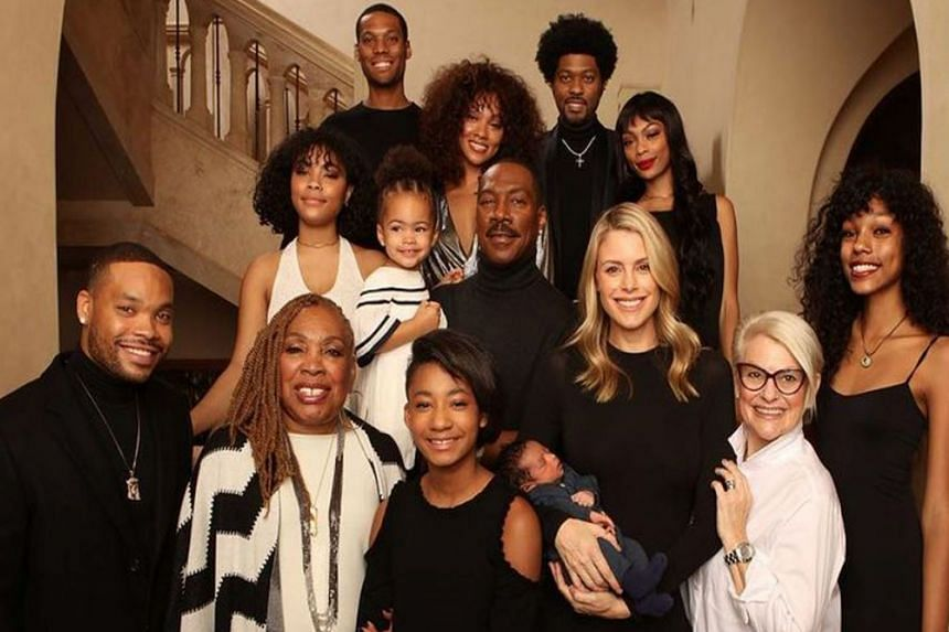 Eddie Murphy (centre) with all 10 of his children in a photo from Christmas 2018.