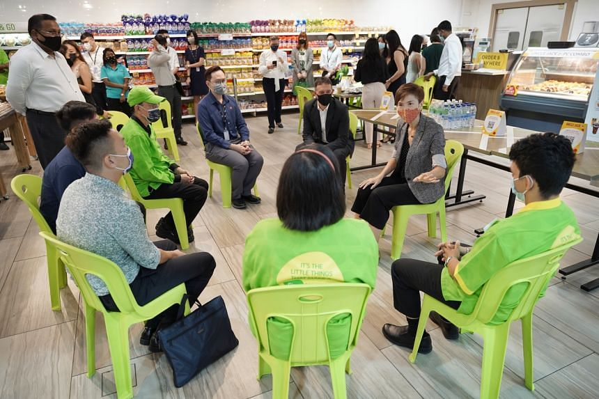 Manpower Minister Josephine Teo speaking to Dairy Farm employees during a visit to Giant Hypermarket in Tampines on March 16, 2021.
