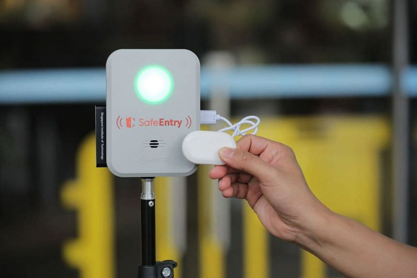 Visitors with the TraceTogether app or TraceTogether token can tap their device on the gateway box to check in.