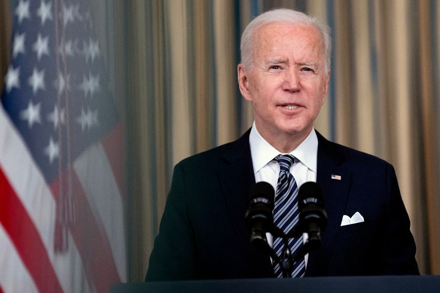 US President Joe Biden speaks to reporters at the White House on March 15, 2021.