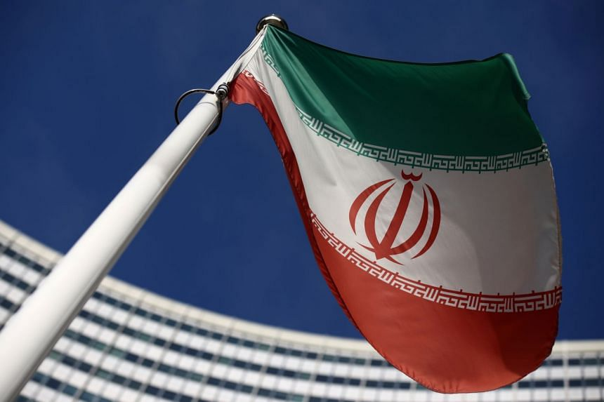 The Iranian flag in front of the International Atomic Energy Agency headquarters in Vienna, Austria.