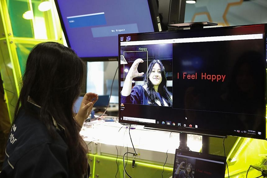 A Higher Nitec student at ITE College West demonstrating her smart artificial intelligence (AI) sign language software in a showcase of social impact AI projects, at the launch of the AI For Citizens online micro-learning course yesterday. PHOTO: LIA