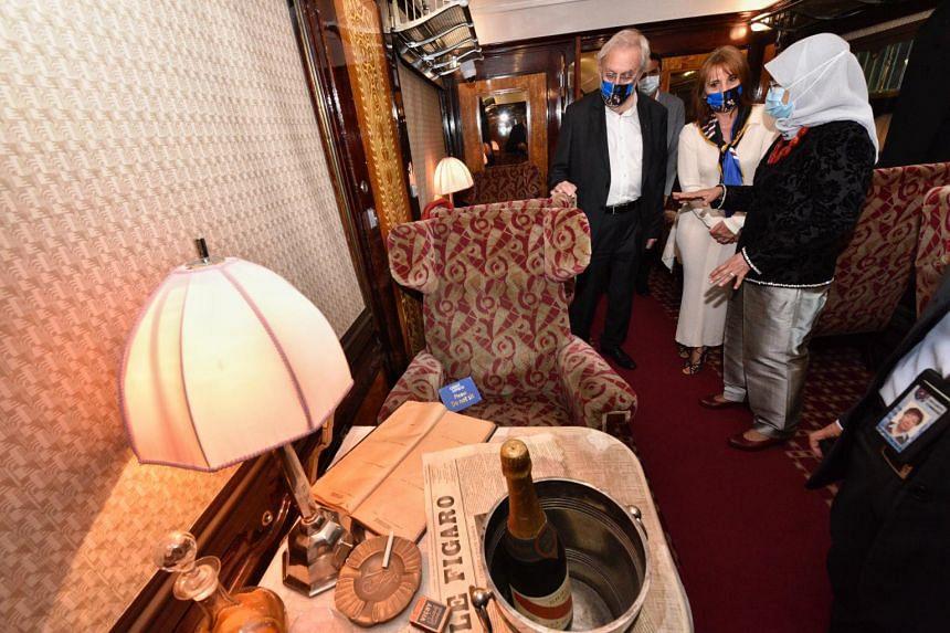 President Halimah Yacob touring the interior of an original first class Pullman carriage.