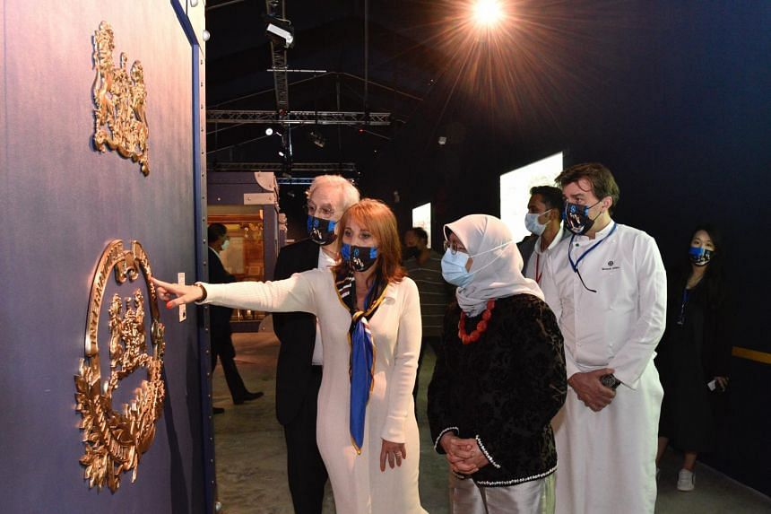 President Halimah Yacob being shown the logo of the Compagnie des Wagons-Lits, the historical operator of the Orient Express.
