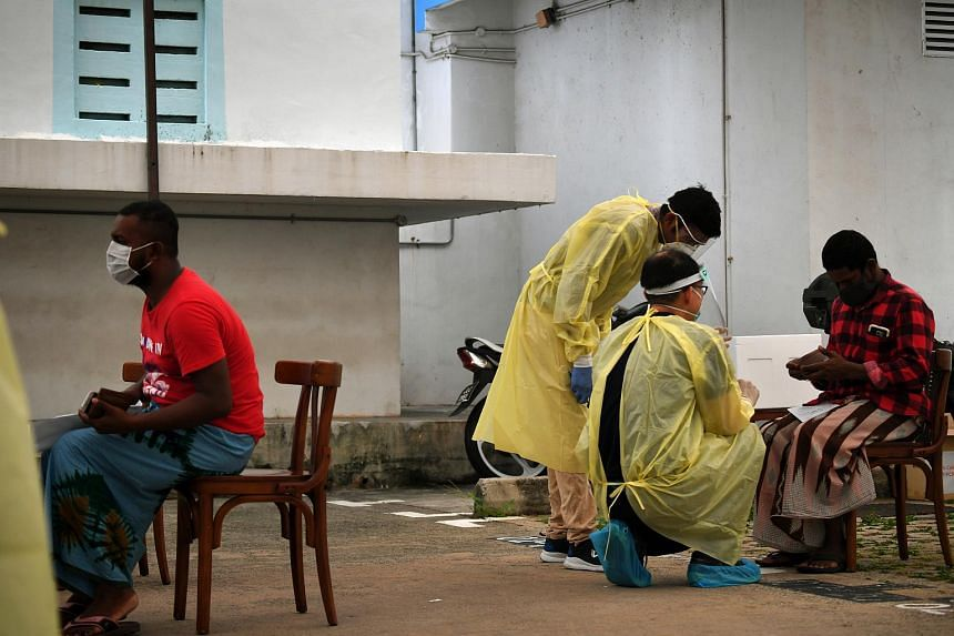 Foreign workers at a swab isolation facility on June 3, 2020.