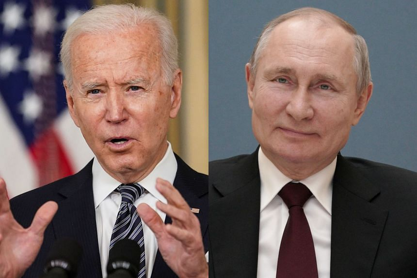 """Biden (left) said Putin (right) would """"pay a price"""" for the interference."""