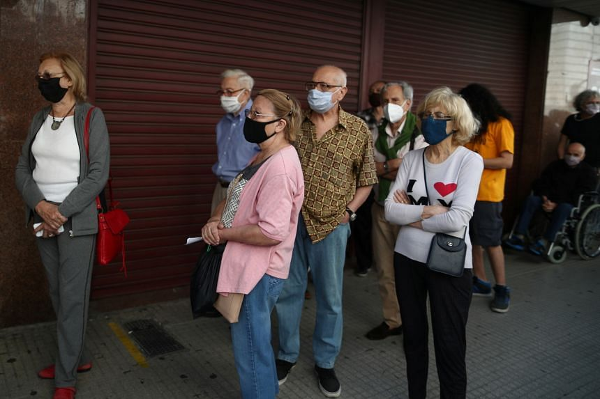 Elderly people wait in line to receive a vaccine against Covid-19 in Buenos Aires, Argentina, on March 9, 2021.