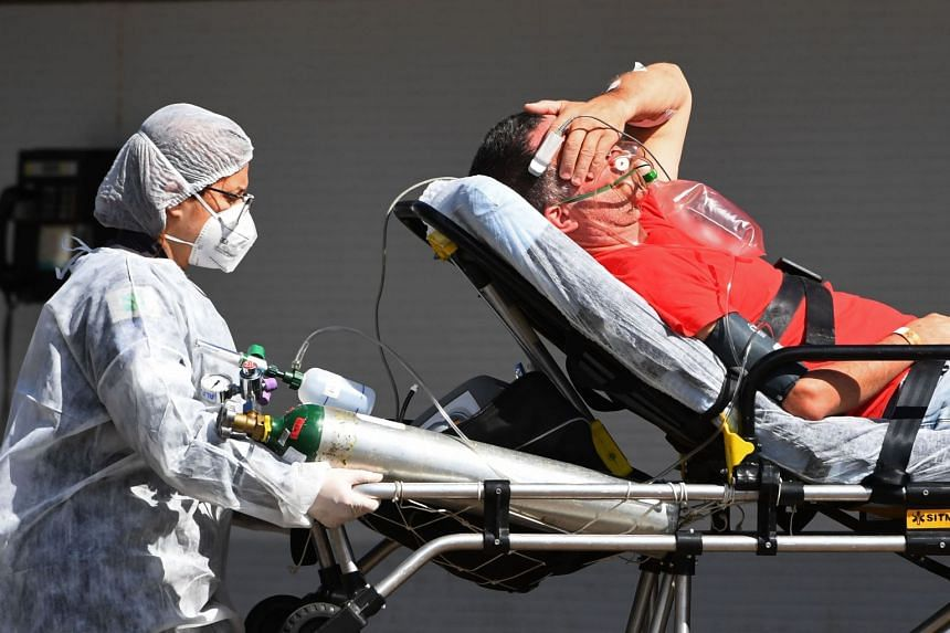 A Covid-19 patient arrives by ambulance at a public hospital in Brasilia on March 15, 2021.