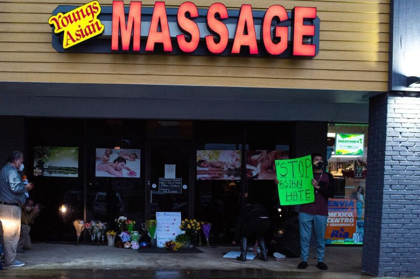 Mourners outside Young's Asian Massage, one of the massage businesses where at least eight people were killed.