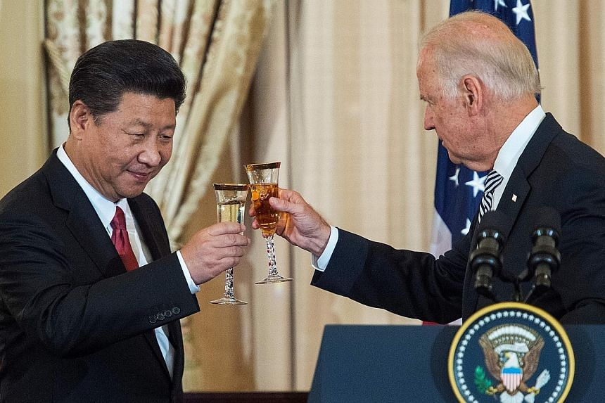 A 2015 file photo showing Chinese President Xi Jinping and then US Vice-President Joe Biden at a state luncheon in Washington. Chinese officials envision a Biden-Xi meeting organised around Earth Day on April 22 to show that both leaders are focused