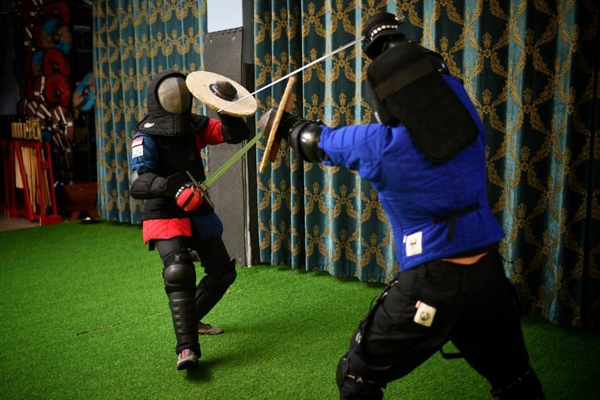 Participants sparring during an Historical European Martial Arts session.