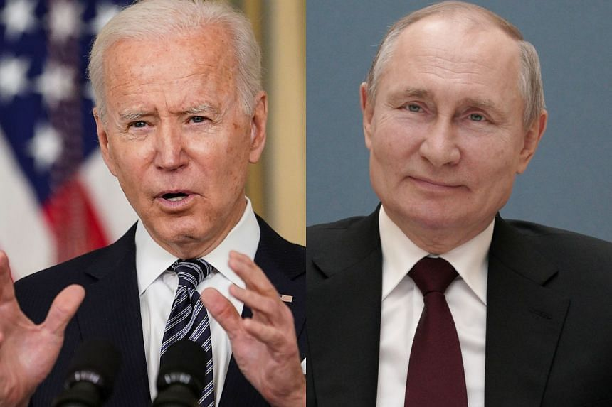 """Biden (left) said Putin would """"pay a price"""" for trying to undermine his candidacy in the US election."""