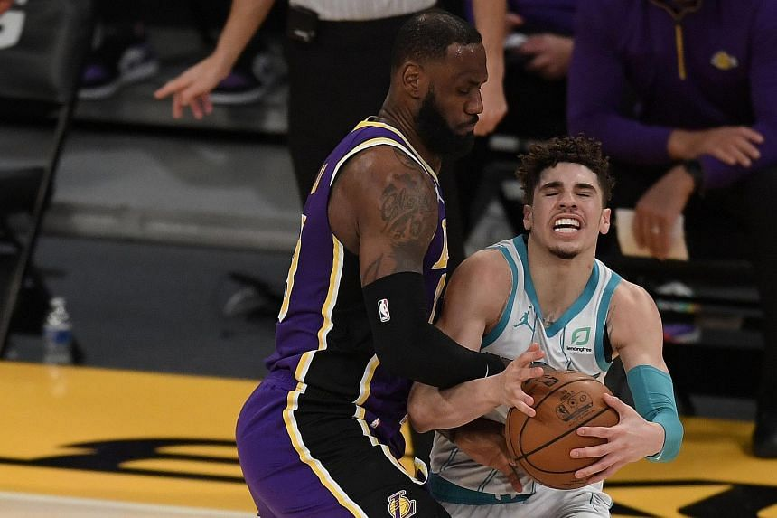Los Angeles Lakers forward LeBron James (left) guarding Charlotte Hornets guard LaMelo Ball, during their NBA match on March 18, 2021.