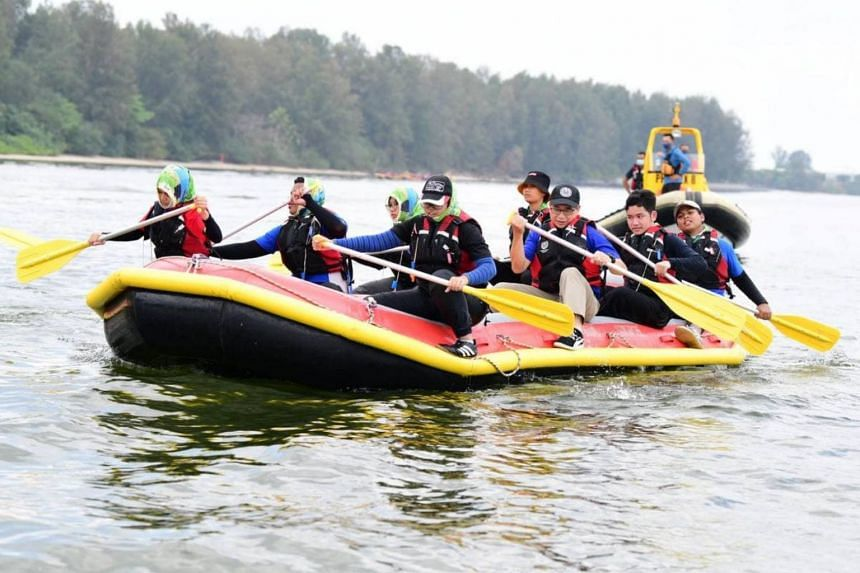 Minister for Culture, Community and Youth Edwin Tong participating in an inflatable rowboat expedition with students on March 19, 2021.