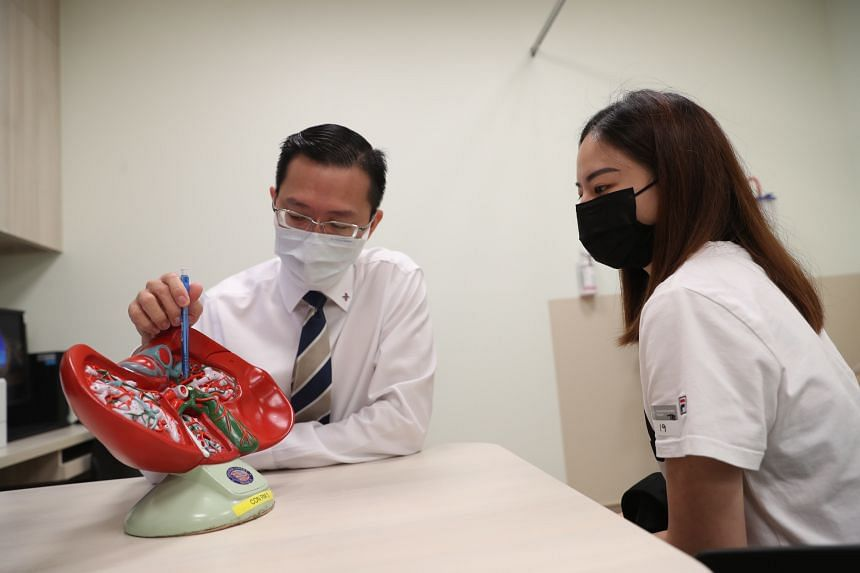 Liver donor Sophia Chua speaking with Associate Professor Alfred Kow at the National University Centre for Organ Transplantation.