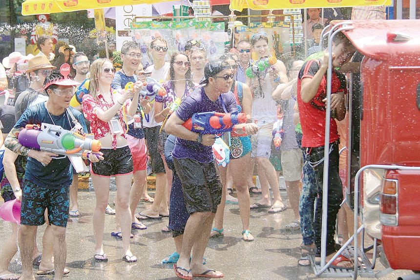 In a normal year crowds pack the streets spraying water guns.