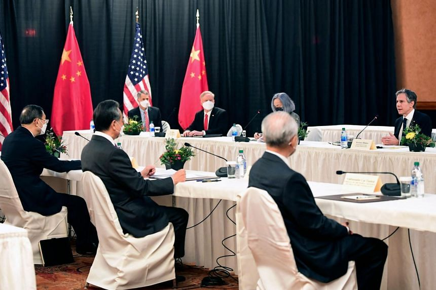 Mr Antony Blinken (right) speaks while facing Mr Yang Jiechi (left) and Mr Wang Yi (second from left) at the opening session of US-China talks in Anchorage on March 18, 2021.