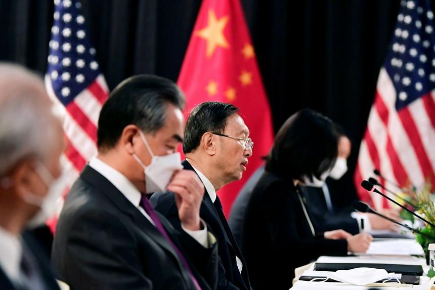 Mr Wang Yi and Mr Yang Jiechi (second and third from left) speak with their US counterparts at the opening session of US-China talks in Anchorage, Alaska.