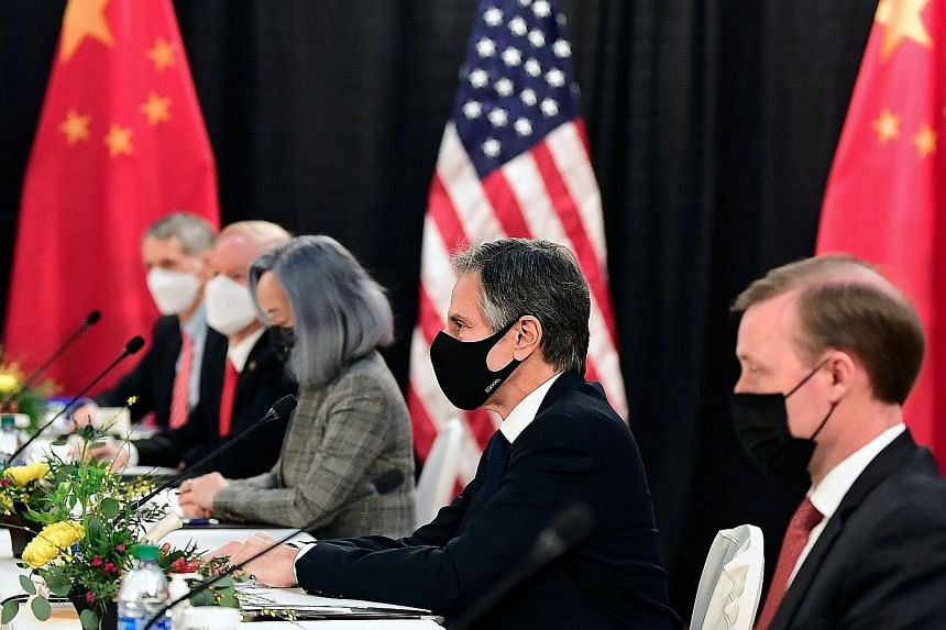 "The US delegation led by Secretary of State Antony Blinken (centre) and National Security Adviser Jake Sullivan (right). Mr Blinken cited ""deep concerns"" about Chinese repression of Muslims in Xinjiang, erosion of democracy in Hong Kong and aggressiv"