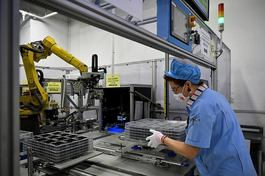 Jiejie Semiconductor Company employees at work in a factory in Nantong, in eastern China's Jiangsu province. China's shift into higher-value manufacturing, including semiconductors and components, has eroded the global market share of producers here,
