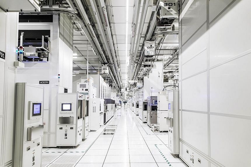 GlobalFoundries' cleanroom in Woodlands. While manufacturing still conjures up the image of dirty work environments for most, many producers now operate in cleanrooms and have highly automated facilities. An automated stocker system in Soitec's Singa