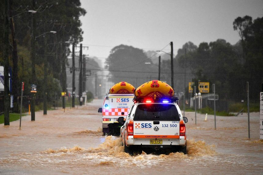 State Emergency Service vehicles approach flooded residential areas in western Sydney, on March 20, 2021.