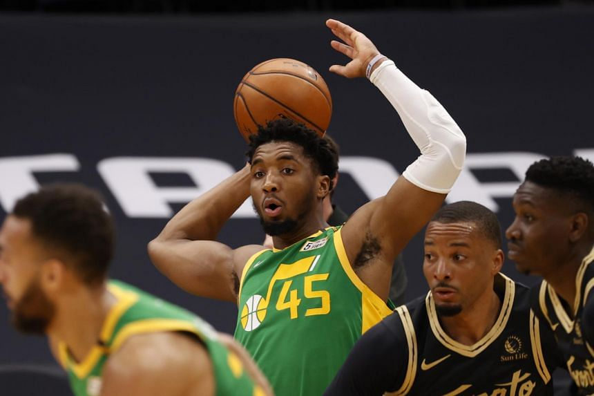 Utah Jazz guard Donovan Mitchell grabs the ball against the Toronto Raptors during the second quarter at Amalie Arena.
