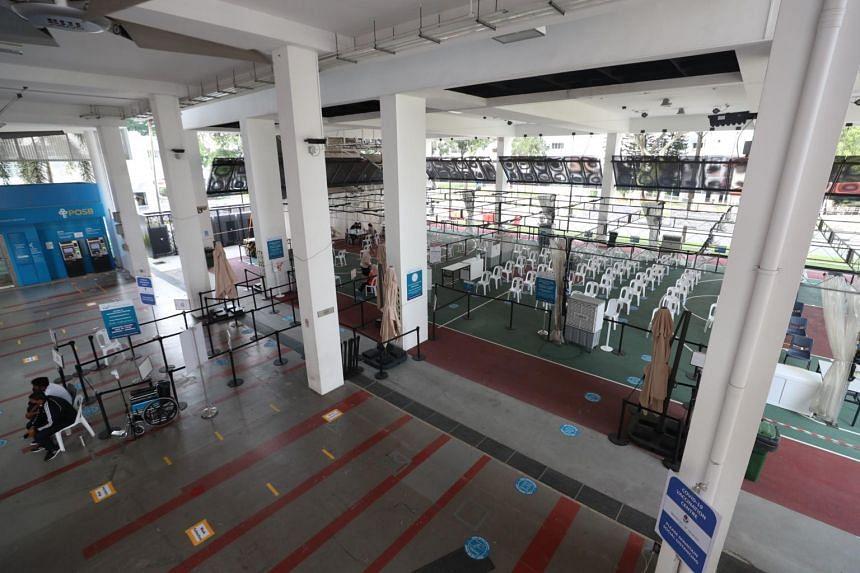 The vaccination booking area at Taman Jurong vaccination centre.