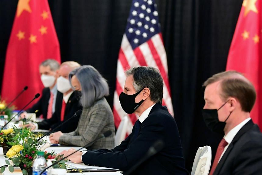 The US delegation led by Mr Antony Blinken (centre) face their Chinese counterparts at the US-China talks in Alaska, on March 18, 2021.