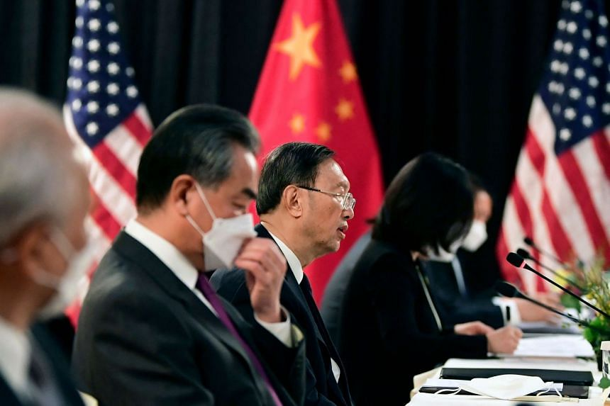 The Chinese delegation led by Mr Yang Jiechi (centre) and Mr Wang Yi (second from left) speak with their US counterparts in Alaska, on March 18, 2021.