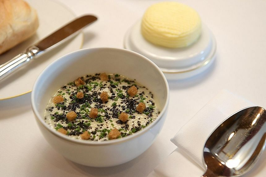 Standout items in the dinner menu include (above, from left) Jerusalem artichoke cream topped with truffles, chives and croutons; Wagyu millefeuille; and cappuccino, a dessert of amaretto gel, coffee cremeux and crisp coffee rolls. The restaurant is