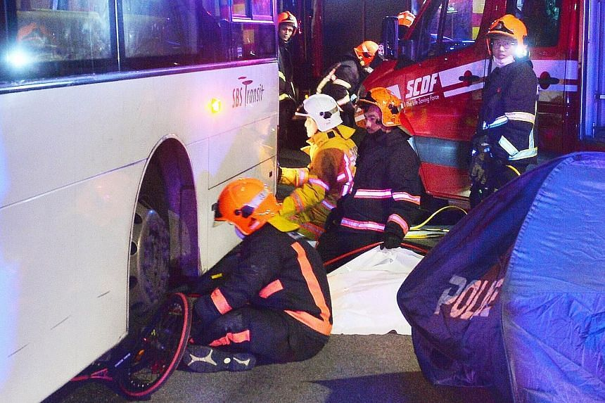 The accident on Friday night left a 31-year-old cyclist trapped under a bus along Loyang Avenue. The Singapore Civil Defence Force said it used lifting equipment to rescue the cyclist but he was pronounced dead at the scene by a paramedic.