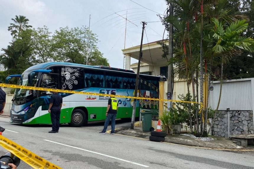 On Sunday morning, a bus was seen entering the embassy grounds.