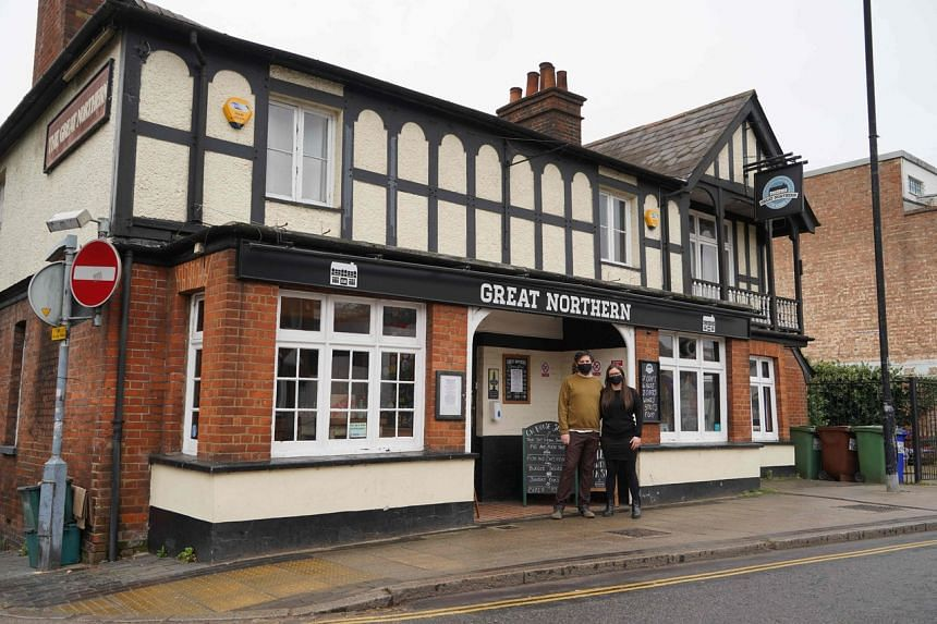 Ms Emma Parkhouse and Mr Sheridan Edwards outside the Great Northern pub in St Albans, north of London on March 18, 2021.