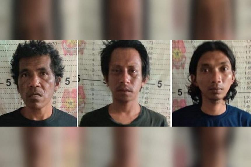 Three of the four Indonesian hostages rescued are (from left) Arizal Kasta Miran, Arsad Bin Dahlan and Andi Riswanto.