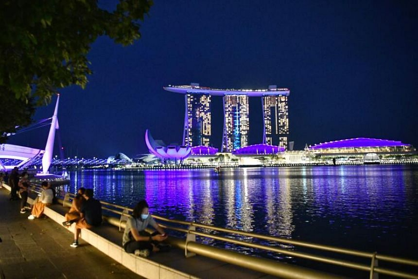 The Marina Bay Sands, Art Science Museum, Helix Bridge and the Singapore Flyer decked in blue on March 20, 2021.