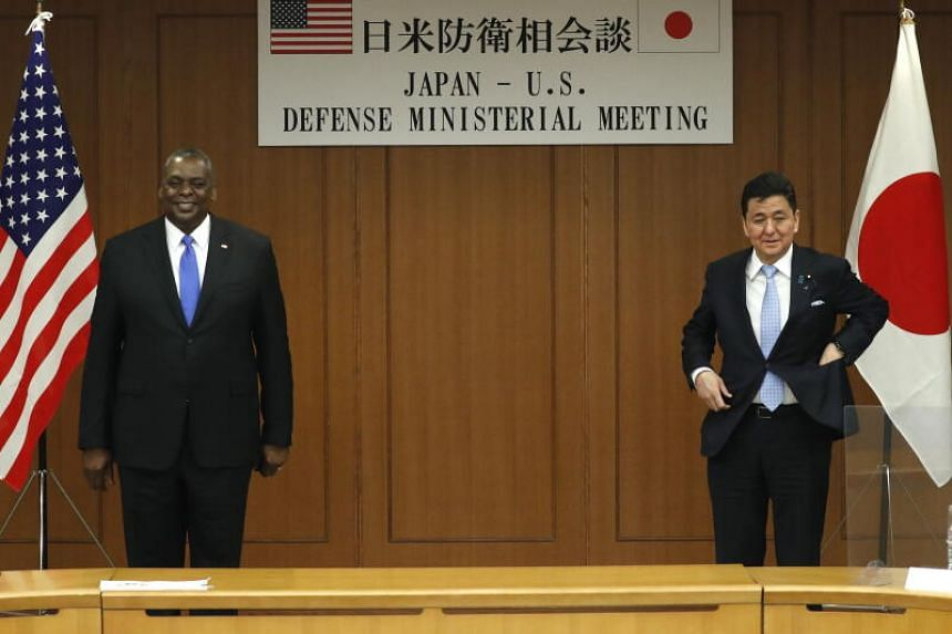 US Secretary of Defence Lloyd Austin (left) with Japan's Defence Minister Nobuo Kishi at the Defence Ministry in Tokyo on March 16, 2021.