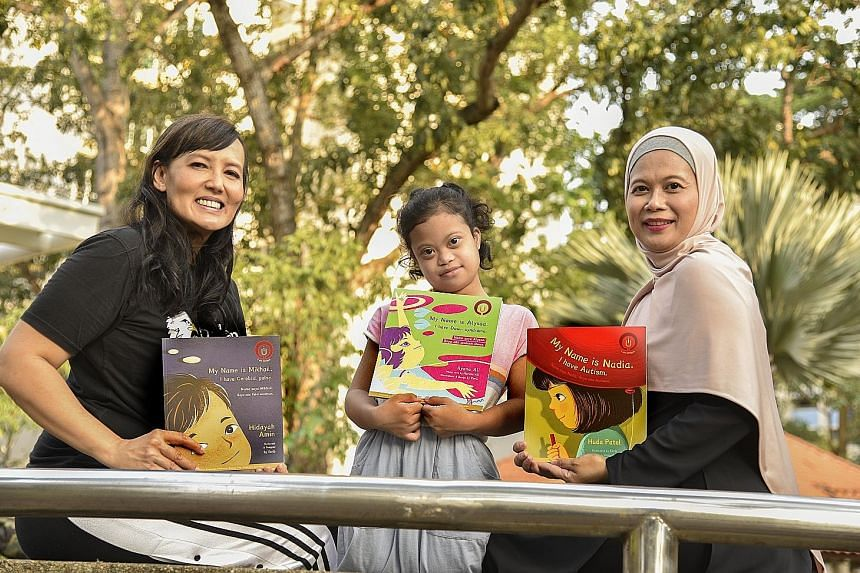 Ilyana Ali (left) wrote My Name Is Alyssa. I Have Down Syndrome, from the point of view of her daughter Nur Alyssa Mohd Azli (centre). The book is part of the I Am Unique series, which includes My Name Is Mikhail. I Have Cerebral Palsy, written by Hi