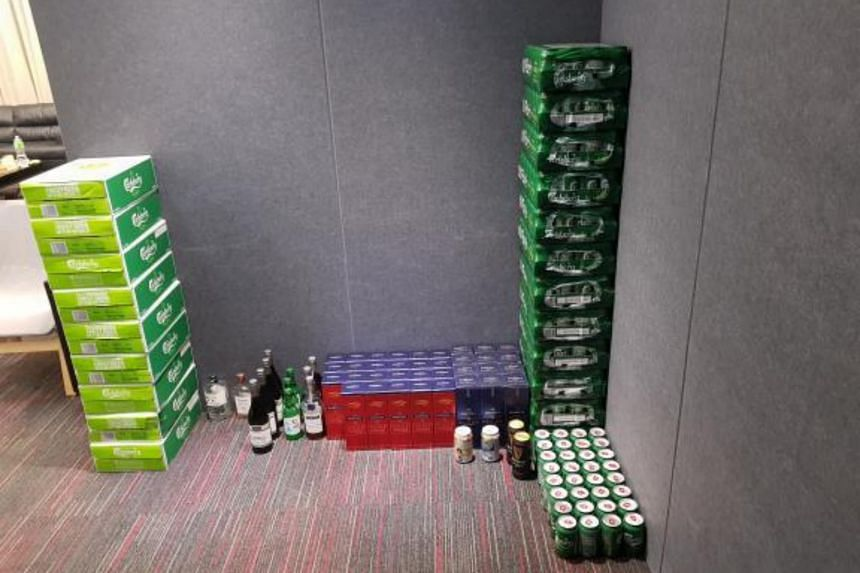 Drinks that were seized by the police at the Pemimpin Drive unit.