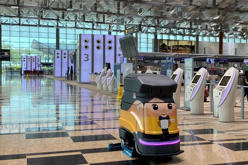 An autonomous floor scrubbing robot helping to keep the premises of Changi Airport spotless. PHOTO: CHANGI AIRPORT GROUP