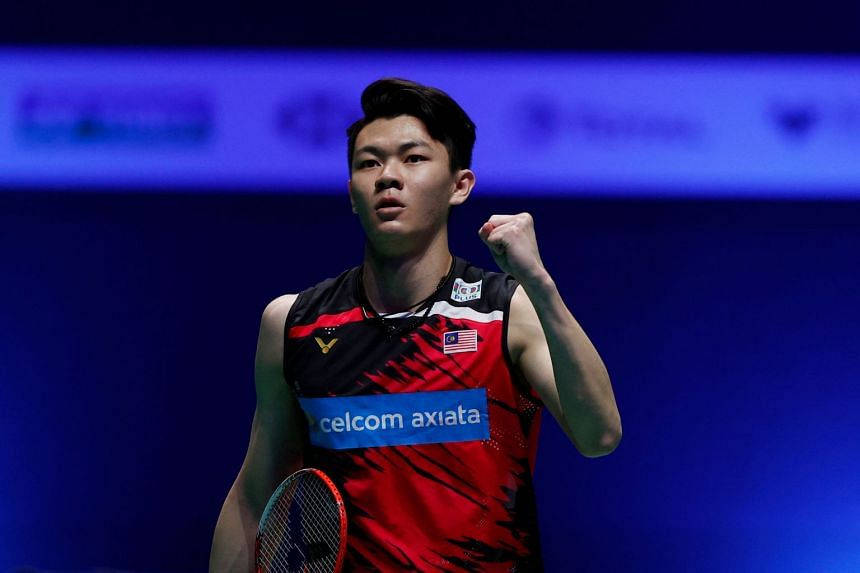 Malaysia's Lee Zii Jia reacts to winning a point against Denmark's Viktor Axelsen during the All England Open Badminton Championship final in Birmingham, on March 21, 2021.