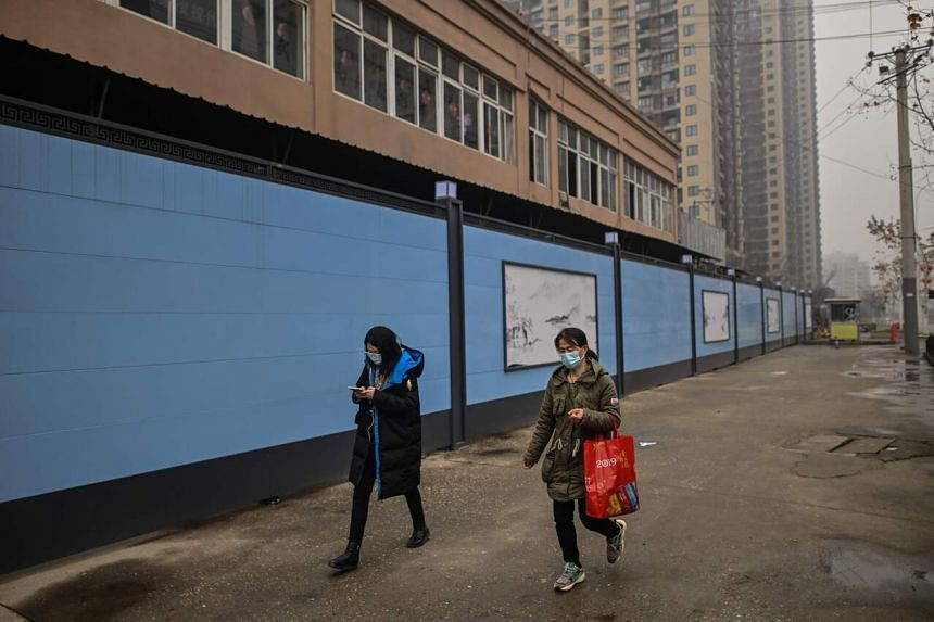 A study of the first 99 patients treated at an infectious diseases hospital in Wuhan found half were linked to the Huanan seafood market.
